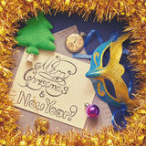 Christmas decorations and congratulatory calligraphic inscription in frame of tinsel. Christmas decorations and congratulatory calligraphic inscription in frame Royalty Free Stock Images