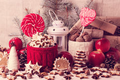 Christmas decorations - cookies, candis apples, nuts, spices.  V Stock Photos