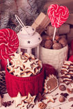Christmas decorations - cookies, candis apples, nuts, spices.  V Royalty Free Stock Photography