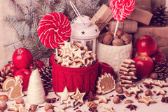 Christmas decorations - cookies, candis apples, nuts, spices.   Royalty Free Stock Images