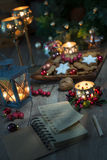 Christmas decorations with cookies, candles and recipe book. Christmas decorations with cookies, candles and lantern. Focus on recipe book Royalty Free Stock Photos