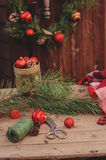 Christmas decorations at cozy wooden country house, outdoor setting on table Stock Images