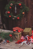 Christmas decorations at cozy wooden country house, outdoor setting on table Stock Image