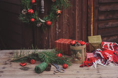 Christmas decorations at cozy wooden country house, outdoor setting on table Stock Photography
