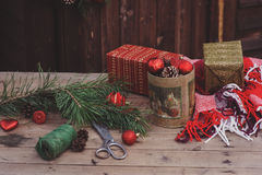 Christmas decorations at cozy wooden country house, outdoor setting on table Stock Photo