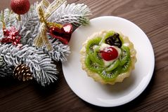 Christmas decorations and cupcake Royalty Free Stock Photo