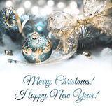 Christmas decorations in cyan and gold, text space stock photography