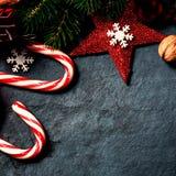 Christmas decorations on dark background, vintage retro style. W Stock Photos