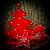 Christmas decorations on dark wood Royalty Free Stock Photo