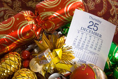 Christmas Decorations with Date. Christmas Decorations with calendar page showing 25 December Royalty Free Stock Photo