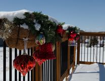 Christmas decorations on the deck covered in snow stock photos