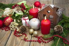 Christmas decorations. Christmas decoration with red candle on the wooden table Royalty Free Stock Photography