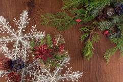 Christmas decorations. Christmas decoration with snowflakes, pine branches on a wooden board stock photography