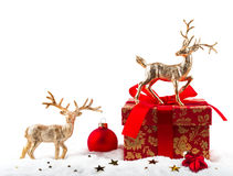 Christmas decorations: deer and festive gift Royalty Free Stock Images