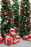 Christmas decorations display. An indoor Christmas display with decorated trees and packages Stock Photo