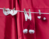 Christmas decorations with dress of santa claus Royalty Free Stock Image