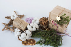 Christmas decorations eco cotton flowers, cinnamon,stars, spruce branches and jute rope hank over white background,holiday,xmas,ch Stock Images