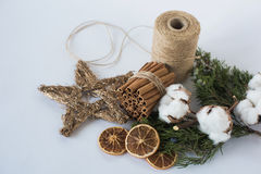Christmas decorations eco cotton flowers, cinnamon,stars, spruce branches and jute rope hank over white background,holiday,xmas,ch Stock Photos
