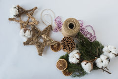 Christmas decorations eco cotton flowers, cinnamon,stars, spruce branches and jute rope hank over white background,holiday,xmas,ch Royalty Free Stock Photo
