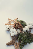 Christmas decorations eco cotton flowers, cinnamon,stars, spruce branches and jute rope hank over white background,holiday,xmas,ch Royalty Free Stock Photography