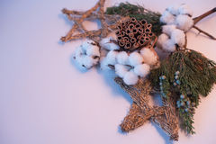 Christmas decorations eco cotton flowers, cinnamon,stars, spruce branches and jute rope hank over white background,holiday,xmas,ch Royalty Free Stock Images
