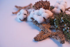 Christmas decorations eco cotton flowers, cinnamon,stars, spruce branches and jute rope hank over white background,holiday,xmas,ch Stock Photo