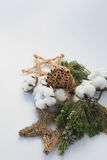 Christmas decorations eco cotton flowers, cinnamon,stars, spruce branches and jute rope hank over white background,holiday,xmas,ch Royalty Free Stock Image