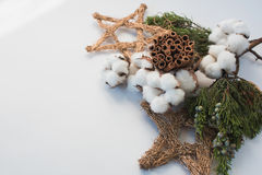 Christmas decorations eco cotton flowers, cinnamon,stars, spruce branches and jute rope hank over white background,holiday,xmas,ch Stock Image