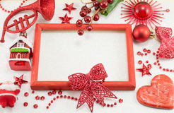 Christmas decorations and empty picture frame Royalty Free Stock Images