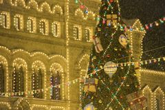 Christmas decorations, big xmas tree with balloons and presents blurry. New Year in Moscow, Russia. Heavy snowfall. royalty free stock images
