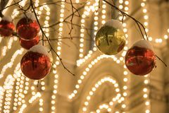 Christmas decorations on a facade, colorful holiday lights, city night illumination. New Year in Moscow, Russia. Heavy snowfall stock image