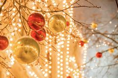 Christmas decorations on a facade, colorful holiday lights, city night illumination. New Year in Moscow, Russia. Heavy snowfall. Christmas decorations on a royalty free stock images
