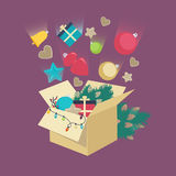 Christmas decorations falling into a box Royalty Free Stock Photography
