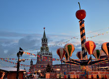Christmas decorations and festivities in Red Square on New Year`s, view of the Kremlin`s Spassky Tower, Moscow, Russia Royalty Free Stock Photos