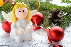 Christmas decorations, figures of angels and notes Royalty Free Stock Photos