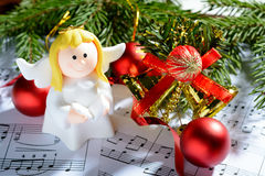 Christmas decorations, figures of angels and notes Royalty Free Stock Photography