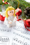Christmas decorations, figures of angels and notes Stock Photography