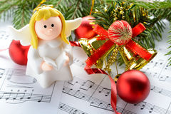 Christmas decorations, figures of angels and notes Stock Image