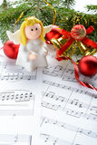 Christmas decorations, figures of angels and notes Stock Images
