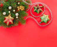 Christmas decorations and fir branch on red Royalty Free Stock Image