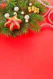 Christmas decorations and fir branch on red Royalty Free Stock Photos