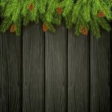 Christmas decorations with fir tree branches and pine cones on b. Christmas background and spruce branches with pine cones. Holiday decorations on black wooden Royalty Free Stock Photos