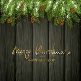 Christmas decorations with fir tree branches and snow on black wooden background. Christmas background and spruce branches with pine cones and snow. Holiday Stock Photos