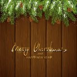 Christmas decorations with fir tree branches and snow on brown w. Christmas background and spruce branches with pine cones and snow. Holiday decorations on brown Stock Photography