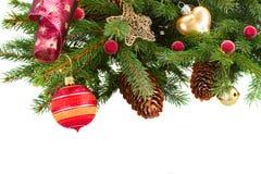 Christmas decorations on fir tree stock image