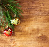 Christmas decorations and fir on a wooden board. top view. filtered image instagram style. Royalty Free Stock Photos