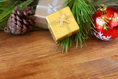 Christmas decorations and fir on a wooden board. top view. filtered image instagram style Stock Photo