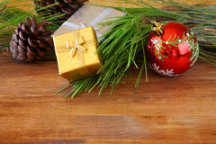 Christmas decorations and fir on a wooden board. top view. filtered image instagram style Stock Photos