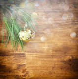 Christmas decorations and fir on a wooden board. top view. filtered image instagram style. Royalty Free Stock Photography