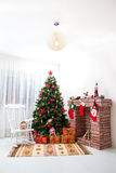 Christmas decorations. With fireplace and rocking chair Royalty Free Stock Images